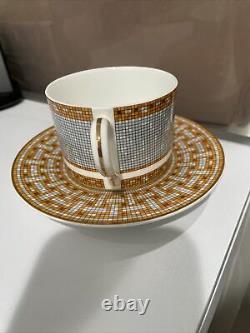Hermes Tea Cup and Saucer Set- Gold/Orange H Logo-New