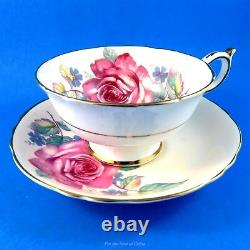Huge Pink Rose on a Peach Background Paragon Tea Cup and Saucer Set