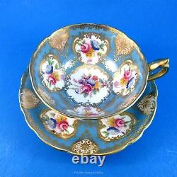 Striking Blue and Rich Gold with Florals Paragon Tea Cup and Saucer Set